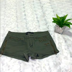 Green army studded booty shorts